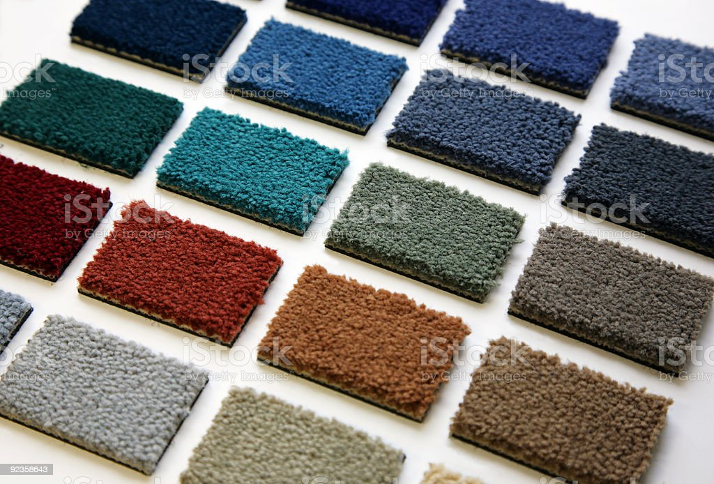 Arrangement of multiple colors of carpet samples stock photo