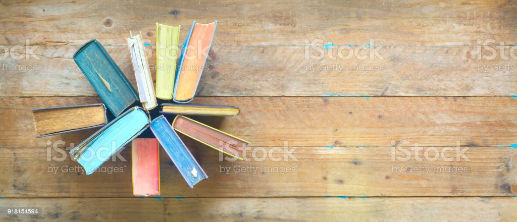 Arrangement of old books, flat lay, free copy space stock photo