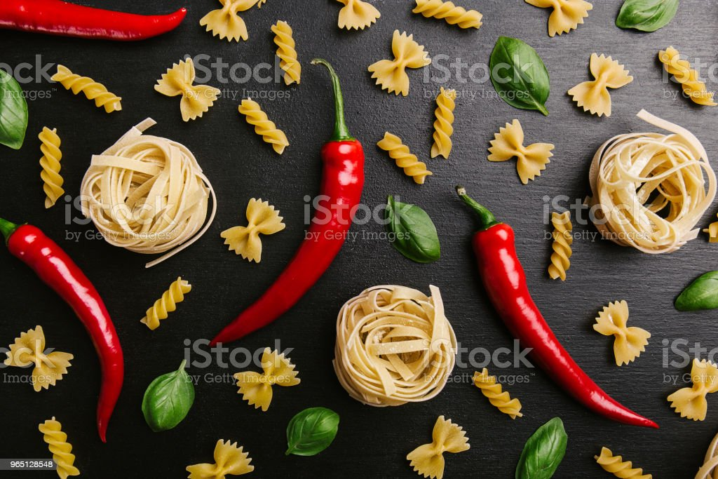 Arrangement of pasta and chili peppers royalty-free stock photo