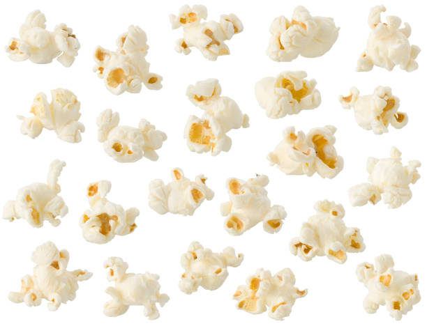 Arrangement of popcorn kernels isolated on white background stock photo
