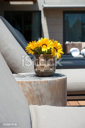 Arrangement of yellow daisies in vase.