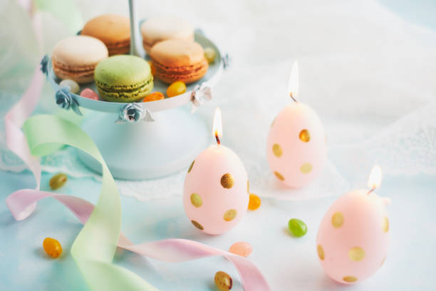 Arrangement with macaroons and easter candles stock photo