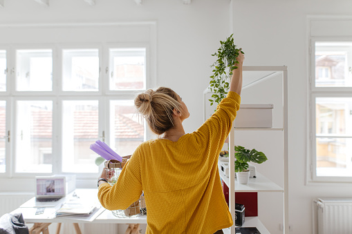 Photo of a woman arranging her new apartment