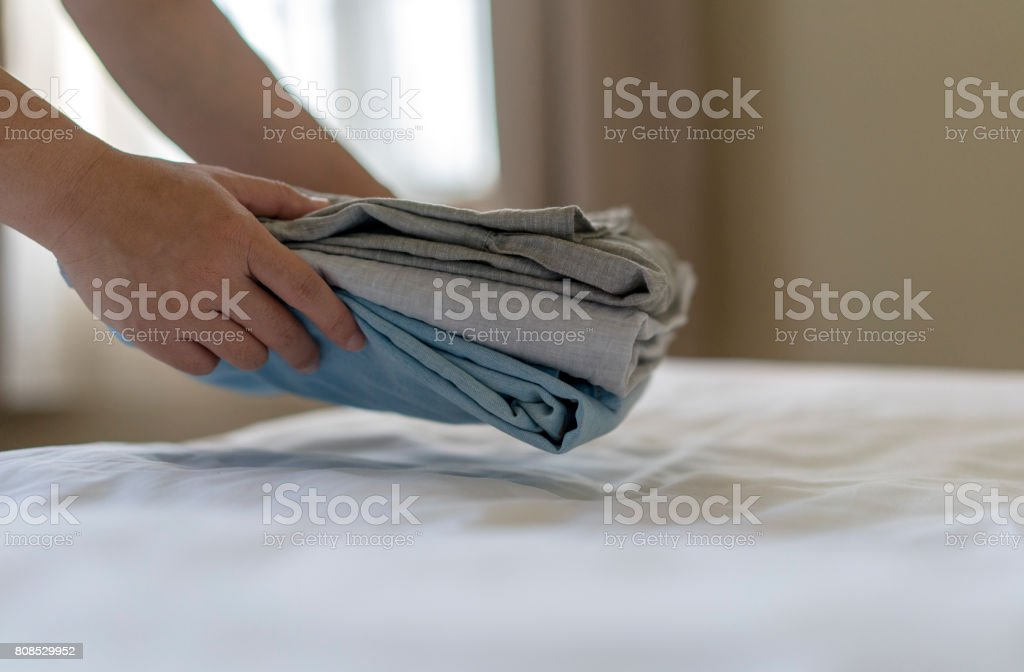 arranging clean clothes stock photo