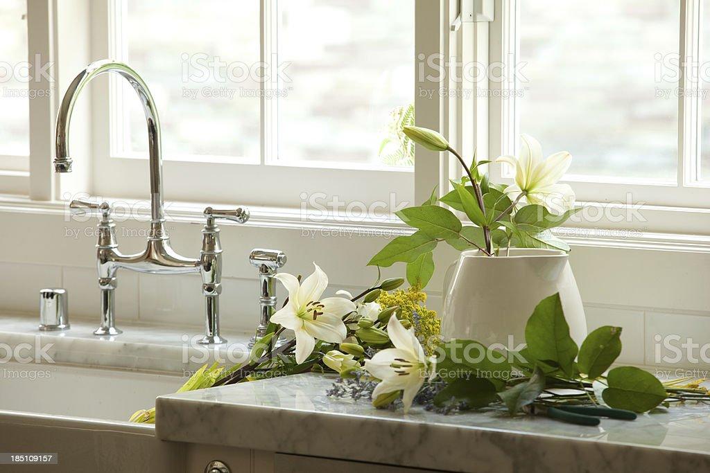 arranging flowers stock photo