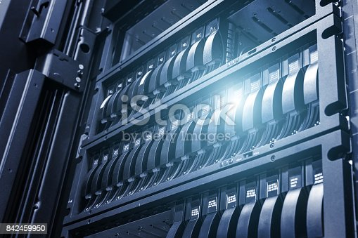 istock Array disk storage in data center with depth of field in cool tone with ligh 842459950