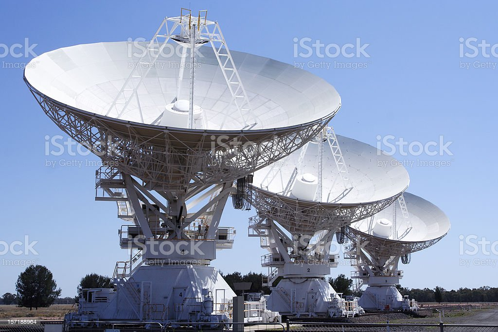 array of deep space radio frequency telescopes stock photo