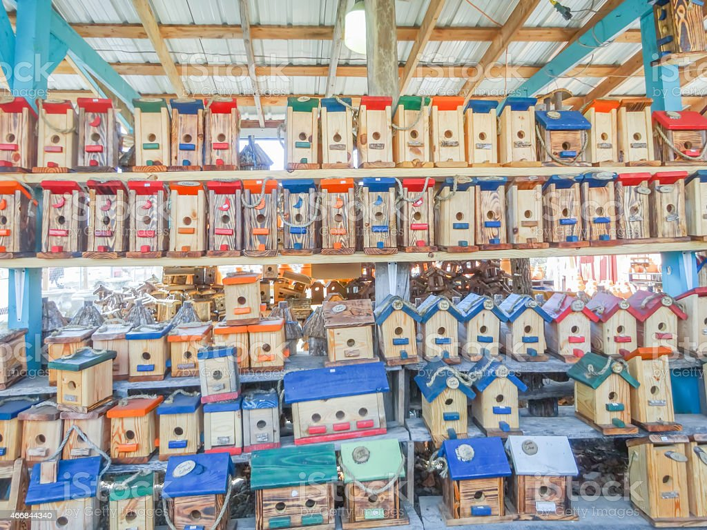 array of handmade birdhouses for sale stock photo
