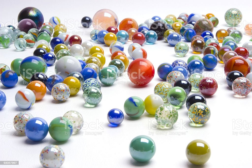 Array of marbles on white counter top stock photo