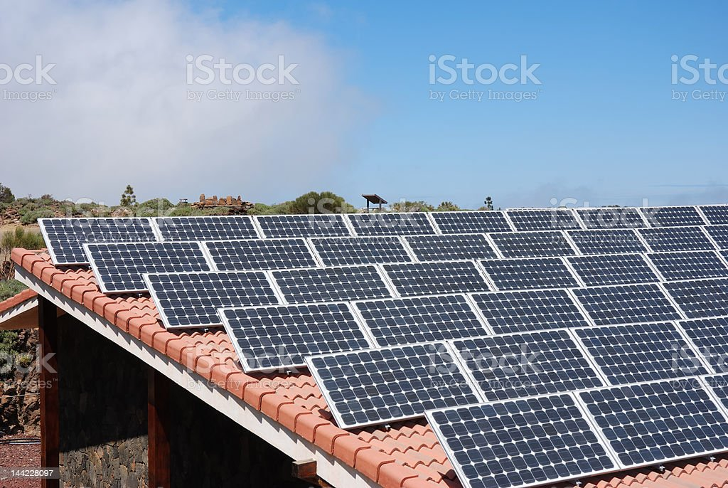 array of solar panels on roof stock photo