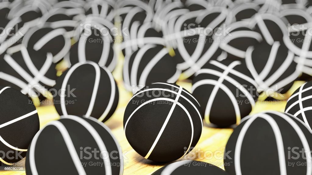 Array of White on Black Basketballs on a Court Surface with Shallow Depth of Field stock photo