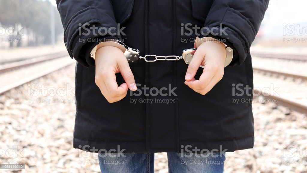 Arrest and handcuff a suspect. stock photo