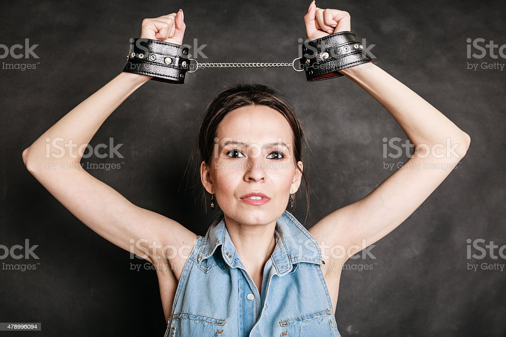Arrest and jail. Criminal woman prisoner girl in handcuffs stock photo