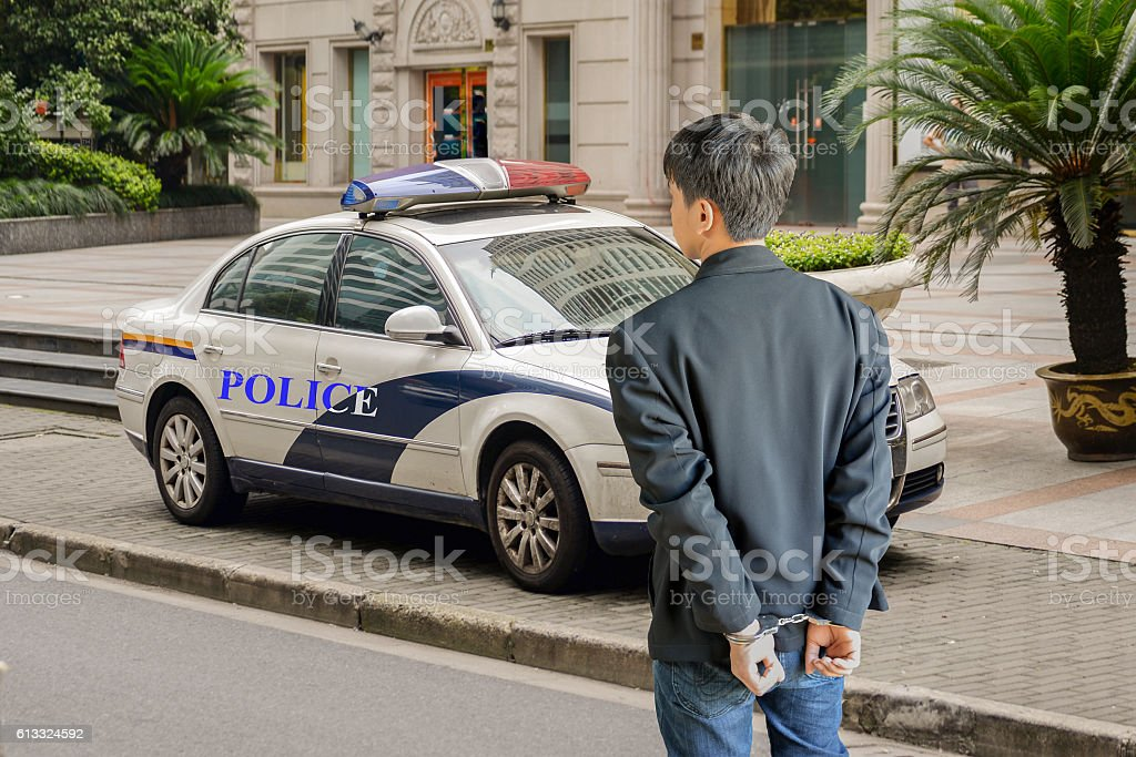 arrested and handcuffed man stock photo
