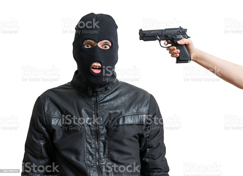 Arrested burglar or robber isolated on white background. stock photo