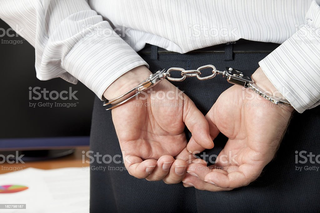 Arrested Businessman stock photo