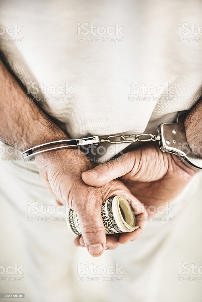 arrested criminal with handcuffs stock photo