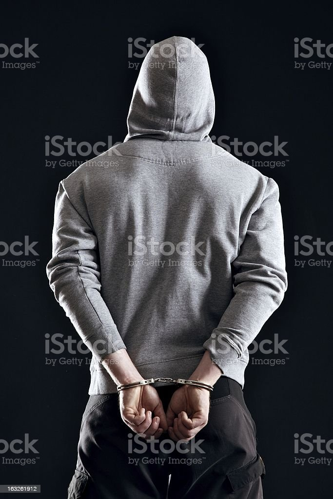 Arrested Gangster in Handcuffs stock photo