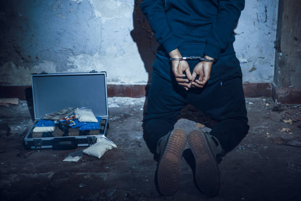 Arrested man in handcuffs stock photo