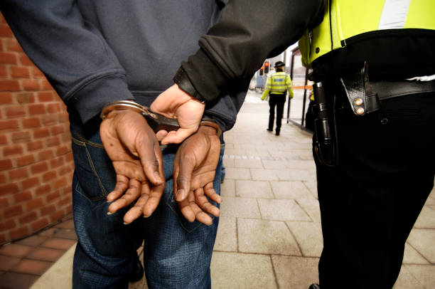 Arrested Young man   arrest stock pictures, royalty-free photos & images