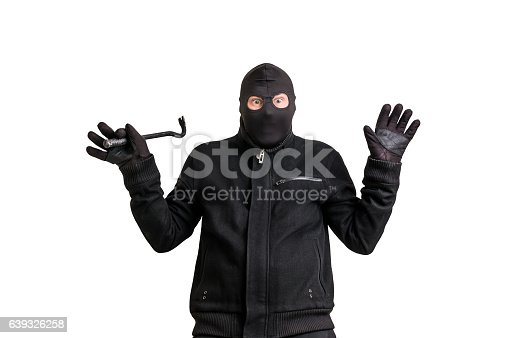 istock Arrested thief in balaclava with crowbar and raised arms 639326258