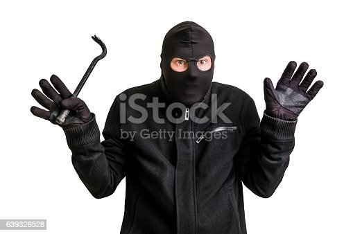 istock Arrested thief in balaclava with crowbar and raised arms 639326528