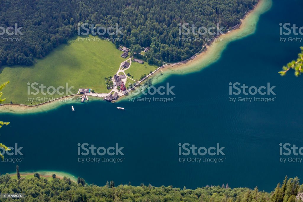 Arrial view to Lake Königssee with St Bartholomä Church stock photo