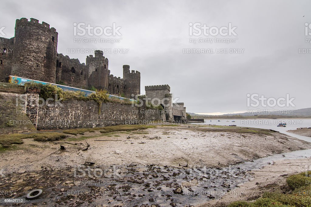 Arriva Trains passing Conwy Castle stock photo