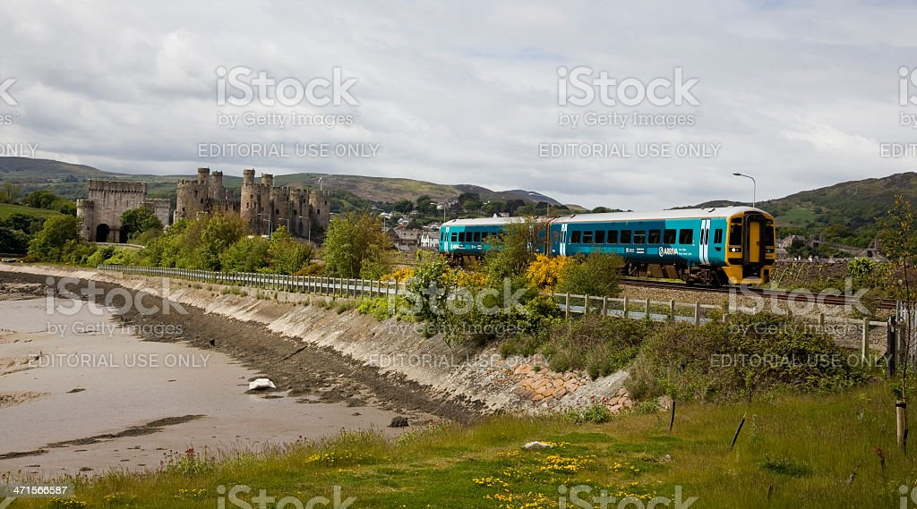 Arriva Trains Wales Passes Conwy Castle stock photo