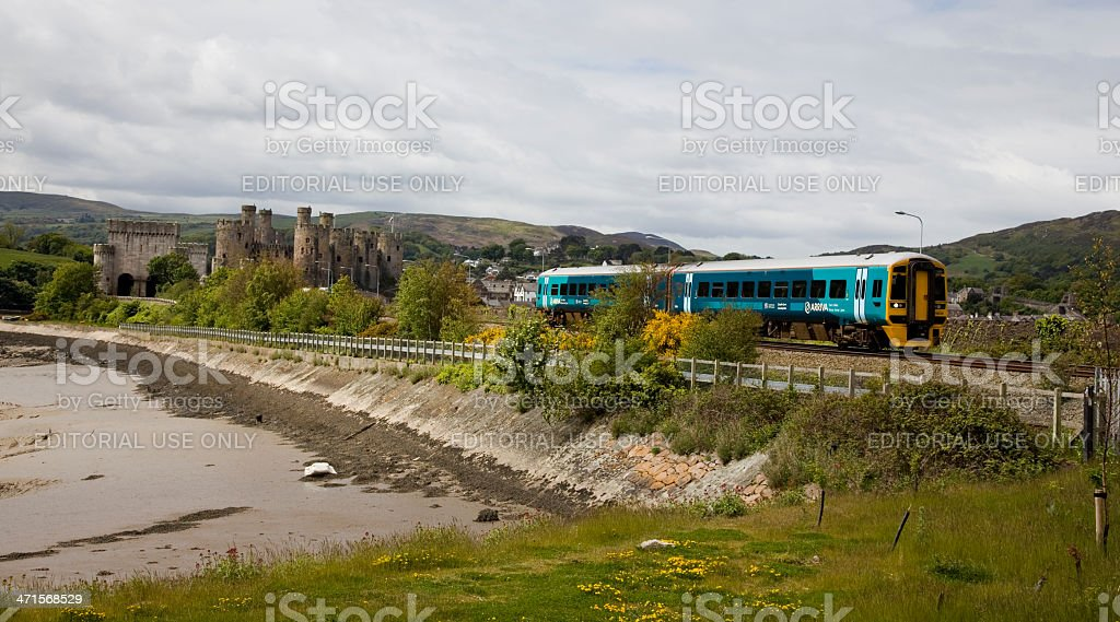 Arriva Trains Wales Train diesel Unit Passes Conwy Castle stock photo
