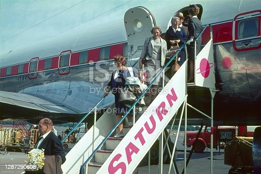 Innsbruck, Tyrol, Austria, 1966. Arrival of a passenger plane at Innsbruck Airport. Passengers leave the aircraft via a gangway.
