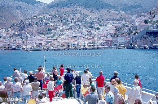 Greece (exact location unfortunately not known), 1978. Arrival by ferry on a Greek island. Furthermore: tourists, harbor, houses and passengers.