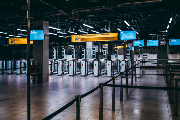 Arrival Immigration Passport Control Point at Amsterdam Schiphol Arrival Immigration Passport Control Point at Amsterdam Schiphol Airport In The Netherlands Europe green card stock pictures, royalty-free photos & images