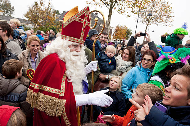 Arrival of Sinterklaas  5 XXL Zaltbommel, the Netherlands - November 16, 2013: The arrival of Sinterklaas in the city of Zaltbommel. Sinterklaas and Zwarte Pieten walking in the streets of Zaltbommel. On the picture Sinterklaas has just arrived by boat from Spain, together with his helpers called Black Petes. Sinterklaas is a winter holiday figure, it's believed that Sinterklaas brings children presents in the evening of the fifth of December. The arrival of Sinterklaas is always somewhere mid november and also celebrated in many places throughout the country. sinterklaas stock pictures, royalty-free photos & images