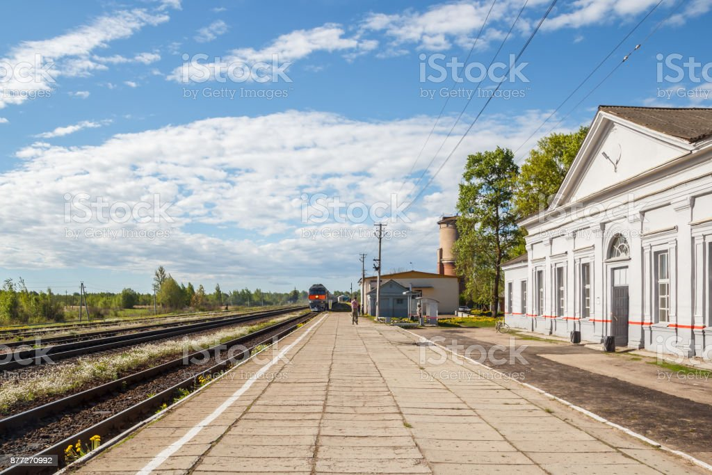 Arrival of the train to the rural railway station stock photo