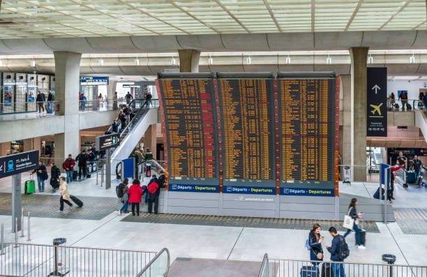 Arrivals and departures board at Charles de Gaulle Airport - Paris, France Paris, France - April 28, 2017: Arrivals and departures board at Charles de Gaulle Airport. CDG is the Europe's second-busiest airport val d'oise stock pictures, royalty-free photos & images