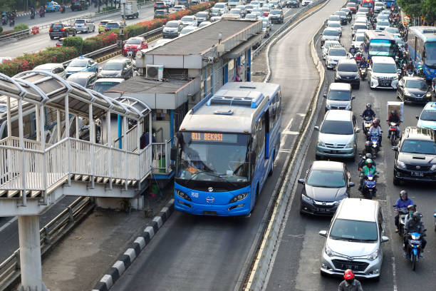 BRT arrived at bus shelter in heavy traffic BRT (bus rapid transit)  arrived at bus shelter in heavy traffic condition on Jendral gatot soebroto street Jakarta. bus rapid transit stock pictures, royalty-free photos & images
