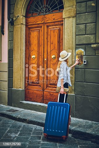 Shot of a woman with her suitcase in a foreign city