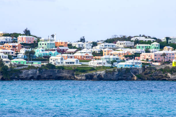 Arriving at the Island of Bermuda we see Colorful Homes on a hillside overlooking the Atlantic Ocean