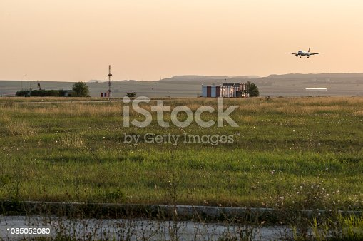 istock Arriving flight at the airport. 1085052060
