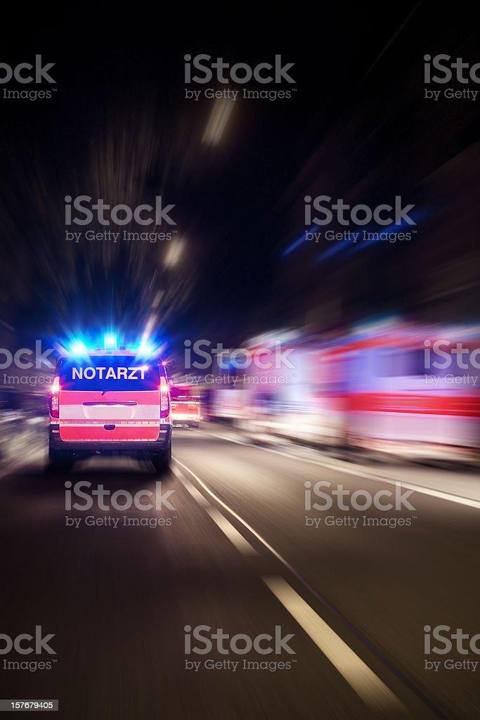Arriving german emergency ambulance, motion blur stock photo