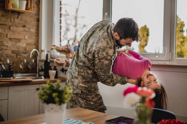 Arriving home after serving with special forces Spending quality time with his family military lifestyle stock pictures, royalty-free photos & images