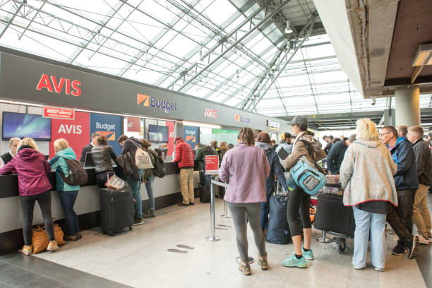 Arriving passengers wait in line to rent cars at Keflavik International Airport, Iceland stock photo