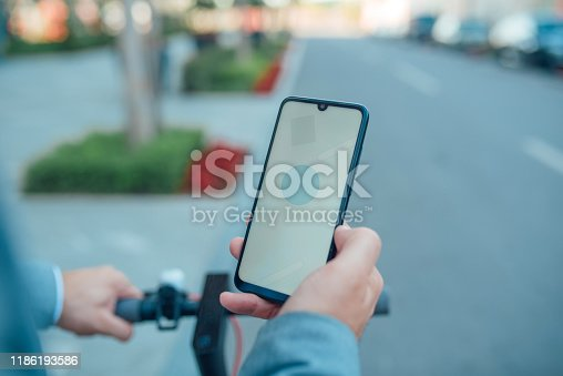 A man arrives at his destination using his phone app GPS