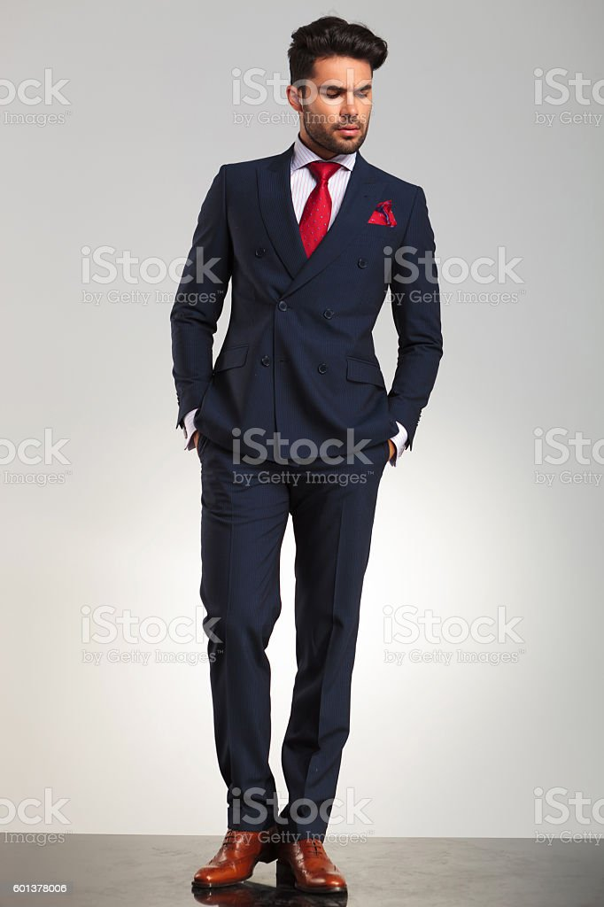 arrogant elegant man in double breasted suit standing stock photo