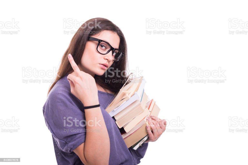 Arrogant girl student carrying books stock photo