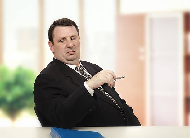 Arrogant interviewer looking at applicant pants Arrogant middle-aged interviewer looking at applicant pants in stress interview adversarial stock pictures, royalty-free photos & images