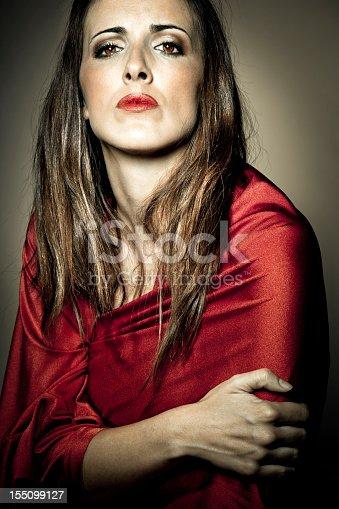 Portrait of arrogant woman in red dress.