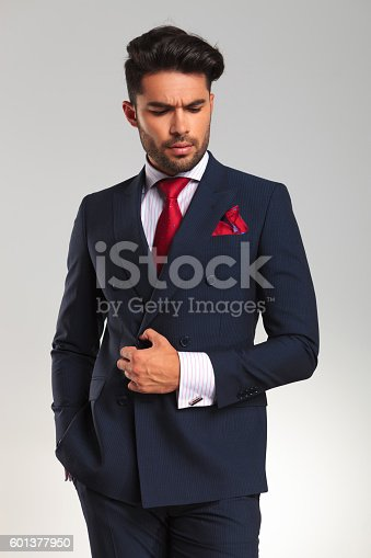 istock arrogant young business man looking to side 601377950
