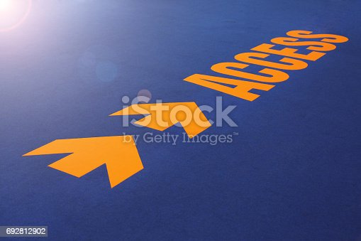 istock Arrow access sign on blue carpet. 692812902